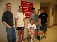 Dr. Carlson, Jenna, Trevor, Terrence, and Keefe outside the Center for Biofilm Engineering office on the MAP students' final day.
