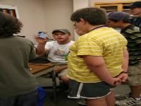 Logan shows the students a kitchen sponge which they examined using the stereoscope.